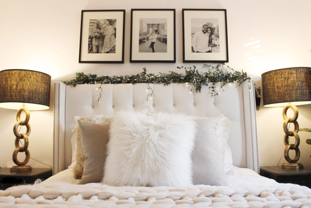 black and white bedroom, gold lamps, faux fur pillows, tufted headboard